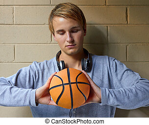 Deep in basketball thoughts - Young cool male thinking of...