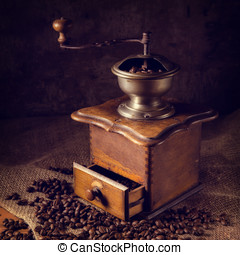 Antique coffee-grinder and beans - antique coffee-grinder...