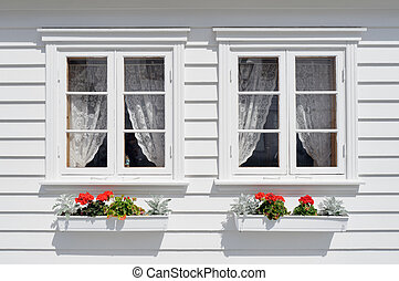 Windows with flowers - Norwegian house