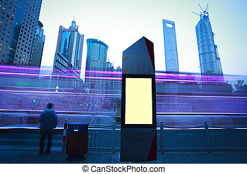 Modern city advertising light boxes - Road car light trails...