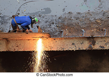 Workers are cutting steel