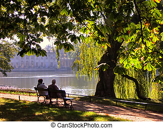 Rest in the park - Senior couple on a late summer day,...