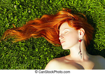 redhead girl - beautiful young redhead girl relaxing lying...