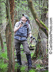 lost hiker in forest with mobile satelite navigation device...