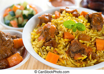 Arabic rice, Ramadan food in middle east usually served with...