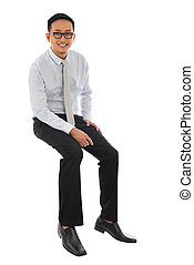 Asian businessman sitting on a tra
