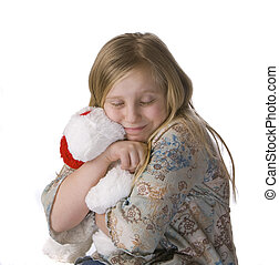 Girl Hugging Stuffed Animal - Girl hugging stuffed animal on...