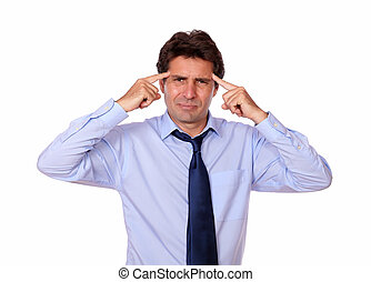 Attractive man with headache holding his forehead