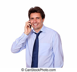 Smiling adult man speaking on cellphone - Portrait of a...