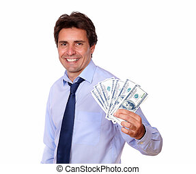 Attractive business man holding up cash money