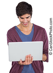 Smiling man using a laptop on a white background