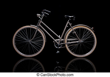 Old refurbished retro bike isolated on black background with...