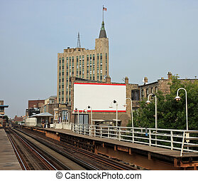 Elevated commuter train in Chicago - Blank sign, near the...