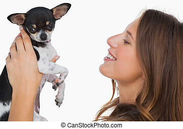 Smiling woman looking at her chihuahua