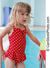 beautiful little girl in the water pool - a beautiful little...
