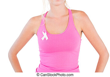 Woman wearing pink tank top and breast cancer ribbonbreast...