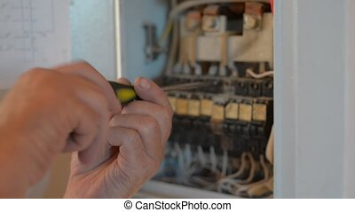 Electrician works on equipment