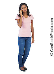 Serious woman calling with her mobile phone