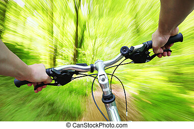 Riding bike through the forest - Riding bike fast through...