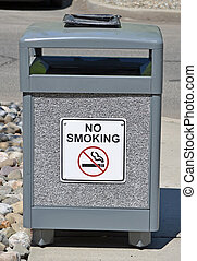Trash Can - A public trash can with a No Smoking sign on it