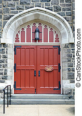 Church Doors - Two large red church doors with a sign that...