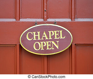 Chapel Open Sign - A red oval sign that reads Chapel Open