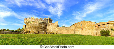 Populonia medieval village landmark, city walls and tower. Tuscany, Italy.