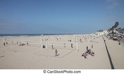 People playing volleyball on beach - Huntington Beach,...