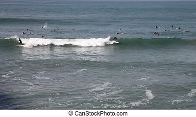 People surfing on the beach - Huntington Beach, California