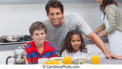 Father and his children smiling at camera