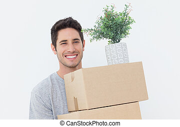 Man holding boxes because he is moving - Handsome man...