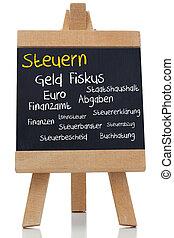 Tax written germman in yellow with a chalk on blackboard on...