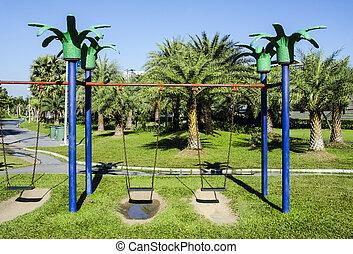 Swingset - Blue swingset on playground