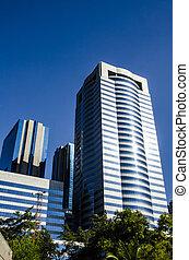 Corporate Buildings - Corporate buildings under blue skies.