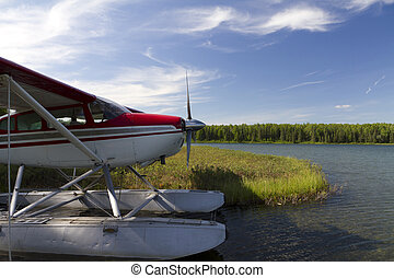 side view of airplane on lake