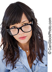 Portrait of a young woman with glasses on white background