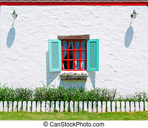 Red & Blue Window with flower pots.