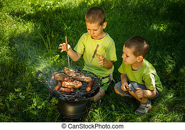 Barbecue party - Brothers having a barbecue party