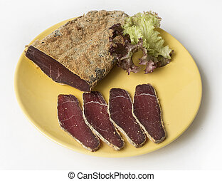 Armenian basturma - jerky beef meat with spices on a plate -...