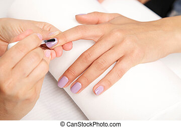 Manicure - Beautiful manicured womans nails with violetnail...