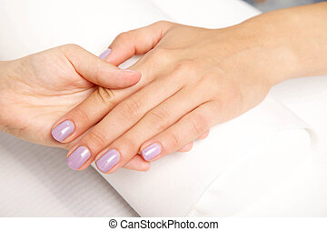 Manicure - Beautiful manicured woman's nails with violetnail...