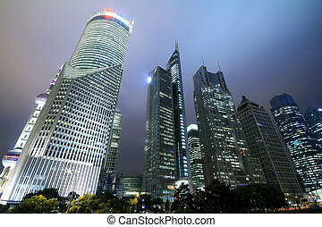 Look up to Shanghai city landmark buildings background night...