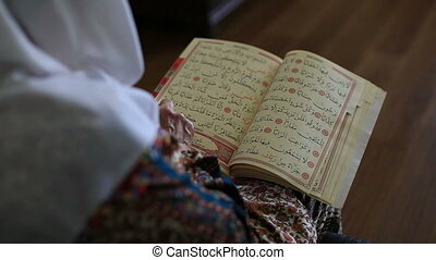 reading Qur'an 5 - reading the Holy Qur'an, shooting close...