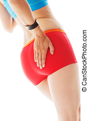 Rear view of a sporty woman in red panties testing her...