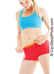 Blonde and perfect shaped woman measuring her waist fitness