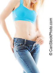 Weight loss shown by a loose jeans