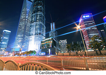 The light trails on modern office building background in shanghai China
