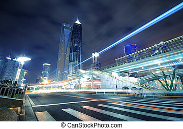 Rainbow light trails on the road in Shanghai Lujiazui -...