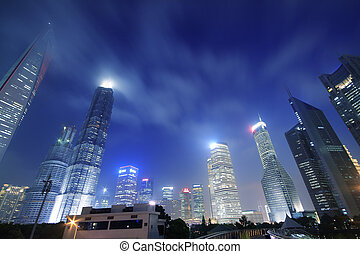 Look up modern office buildings in Shanghai Lujiazui - China...