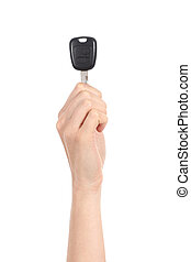 Vertical view of a woman hand holding up a car key -...